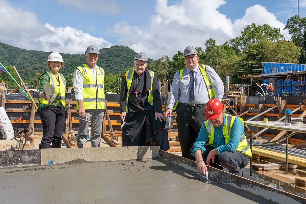 (L-R) Newman Catholic College Foundation Principal Dr Lauretta Graham, James Cook University Cairns Campus Director David Craig, Cairns Bishop James Foley, Cairns Catholic Education Services Deputy Executive Director Ian Davis and Roger Mainwood of TPG Architects used trowels to smooth freshly-poured concrete at the event in March.